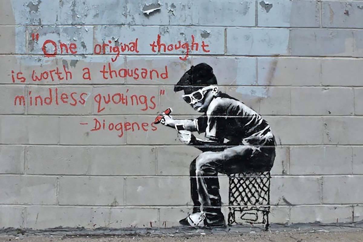 kleine jonge met een citaat van diogenes